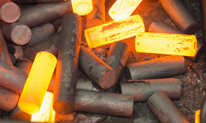 An image of red-hot steel forgings,
