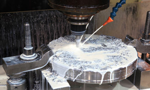 Images of a steel machining mill with lubricant