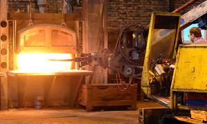 An Image Of A Ring Rolling Machine in a red hot furnace